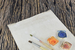 Watercolor paints and old paper Royalty Free Stock Photo