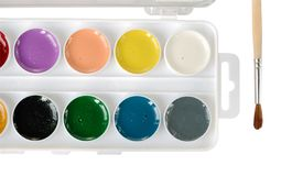 Watercolor paints and paintbrush close up Royalty Free Stock Photo