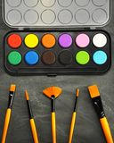 Watercolor paints with paintbrush set royalty free stock image