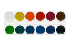 Watercolor paints palette. Simple watercolor paints palette isolated on white background, top view stock photography