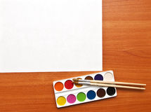 Watercolor paints and paper sheet Royalty Free Stock Photography