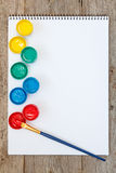Watercolor paints and paper sheet Stock Photo