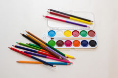 Watercolor paints and pencils Royalty Free Stock Photo