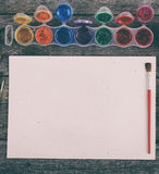Watercolor paints set with brushes and paper sheet Stock Photography