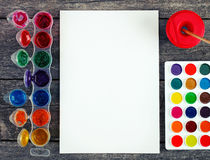 Watercolor paints set with brushes and paper sheet Stock Image