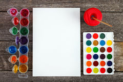 Watercolor paints set with brushes and paper sheet Royalty Free Stock Photography