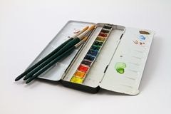 Watercolor paints set with brushes Stock Images