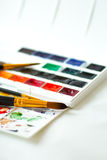 Watercolor paints set, palette and brushes Stock Images