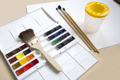 Watercolor paints. On a sheet of paper Stock Image