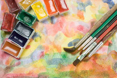 Watercolor palette and brushes Stock Photography