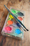 Watercolor palette with brushes closeup Royalty Free Stock Images