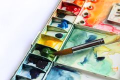 Watercolor palette and Paintbrush royalty free stock photography
