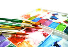 Watercolor palette and paintbrushes Royalty Free Stock Images