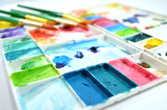 Watercolor palette and paintbrushes Royalty Free Stock Photos