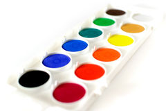 Watercolor palette viewed from side. Simple watercolor palette isolated on white and viewed from the side Royalty Free Stock Images