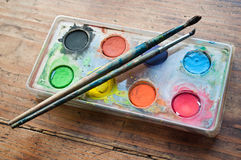 Watercolor palette witth pencils closeup Royalty Free Stock Photo