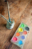 Watercolor palette witth pencils closeup Royalty Free Stock Photography