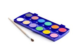 Watercolor pallet with brush. Watercolor pallet with brush isolated on white background royalty free stock photo