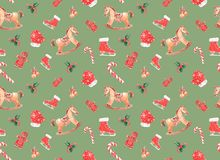 watercolor pattern with Christmas toys on a colored background stock photo