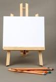 Watercolor pencils and easel Stock Photos