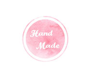 Watercolor pink texture with round sign and hand made text Royalty Free Stock Photos