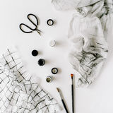 Watercolor, scissors, textile and brushes at white background royalty free stock photography