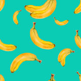 Watercolor seamless pattern with bananas on turquoise background . Stock Images