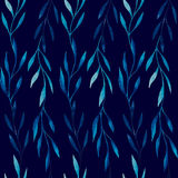 Watercolor seamless pattern of blue leaves on a dark blue background Stock Images