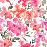 Watercolor seamless pattern with bright loose flowers on white background. Stock Photo