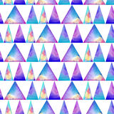 Watercolor seamless pattern. With colofrul triangles on white background. Raibow prink or wallpaper Royalty Free Stock Images