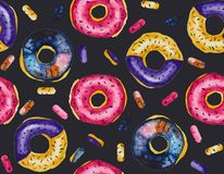 Watercolor seamless Pattern of cosmic donuts coated with glaze. The pattern made in watercolor technique includes delicious looking donuts covered with glaze Royalty Free Stock Images