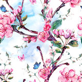 Watercolor seamless pattern with flowers apricot tree branches Stock Photos