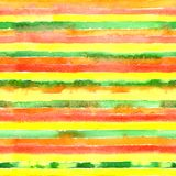 Watercolor seamless pattern with green, yellow, red, orange color stripes. Repeat straight stripes texture background. Hand painted texture Stock Images