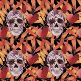 Watercolor seamless pattern. Halloween. Spooky skull with light eyes and autumn leaves. royalty free illustration