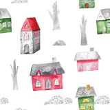 Watercolor seamless pattern with houses and trees. Festive winter decoration. Christmas background. Watercolor seamless pattern with houses and trees. Festive Stock Photos