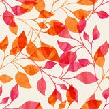 Watercolor seamless pattern with pink and orange autumn leaves. Stock Image