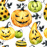 Watercolor seamless pattern, pumpkins with leafes. Halloween holiday illustration. Funny food. Magic, symbol of horror. Baby background. Can be use in holidays Royalty Free Stock Image