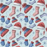 Watercolor seamless pattern with winter hats, socks and mittens. Hand painted ornament with Christmas clothing isolated Royalty Free Stock Image