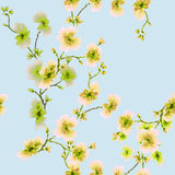 Watercolor seamless pattern yellow and green flowers on a blue background stock photo