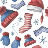 Watercolor seamless winter pattern with hats, socks and mittens. Hand painted ornament with Christmas clothing isolated Royalty Free Stock Photo