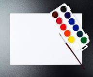 Watercolor set over white paper sheet Royalty Free Stock Photo
