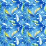 Watercolor silhouettes of flying birds and feathers in the sky. Seamless pattern Royalty Free Stock Images