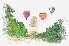 A watercolor sketch or illustration. Hot air balloon in the sky in Kapadokia in Turkey. stock photography