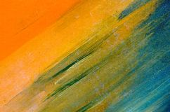 Watercolor smears on the canvas: orange, blue, green. On the diagonal royalty free stock photo