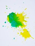 Watercolor splash in green yellow hues on white background. Colorful vivid watercolor splashes in green and yellow hues on white background, watercolor stock images