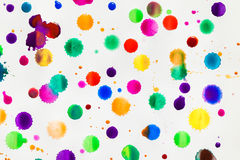 Watercolor splashes, drops and stains on white paper. Stock Photo
