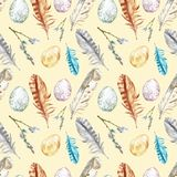 Watercolor spring seamless pattern with easter eggs, willow tree branches, assorted colorful feathers on yellow background. Hand painted spring holiday symbols stock illustration