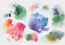 Watercolor stains and splashes. Bright elements for design Stock Image