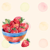 Watercolor strawberry in colored plate on yellow background with colorful splashes. Stock Photos