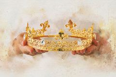 Watercolor style abstract illustration of lady holding gold crown. fantasy medieval period. Watercolor style abstract illustration of lady holding gold crown Royalty Free Stock Photos